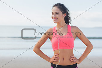 Beautiful smiling healthy with earphones on beach