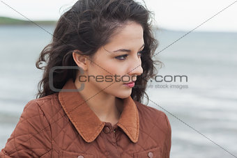 Close up of a cute thoughtful woman on beach