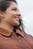Close up of cute smiling woman in stylish brown jacket
