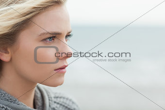 Close up side view of serious cute woman on beach