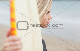 Beautiful woman with surfboard on beach