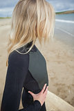 Beautiful blond in wet suit at the beach