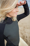 Side view of beautiful blond shielding eyes at beach
