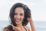 Close up portrait of cute smiling woman at beach