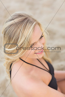 Overhead Close up of a smiling relaxed blond at beach