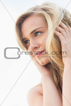 Close up of a smiling relaxed blond looking away