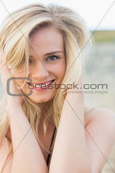 Close up portrait of smiling young blond at beach
