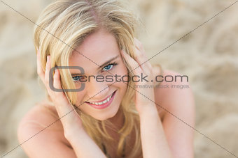 Overhead Close up portrait of smiling relaxed blond at beach