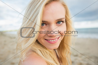Close up portrait of smiling relaxed blond at beach