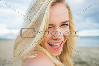Close up portrait of cheerful relaxed blond at beach