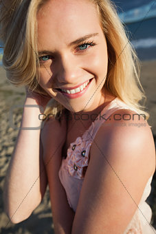 Close up portrait of smiling blond at beach