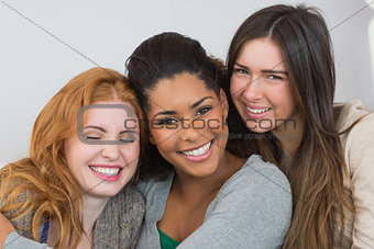 Close up portrait of cheerful young female friends