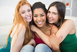 Portrait of happy female friends embracing each other