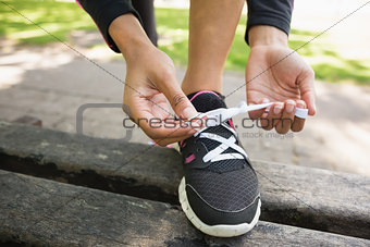 Close up of a sporty young woman wearing shoes in park
