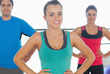 Portrait of smiling toned people at yoga class