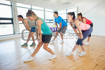 Fitness class and instructor doing power fitness exercise
