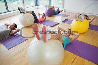 High angle view of class exercising with fitness balls