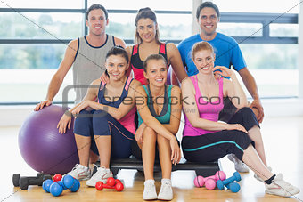 Group of fitness class at a bright exercise room