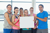 Portrait of a group of fitness class holding blank paper
