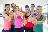 Portrait of fitness class gesturing thumbs up