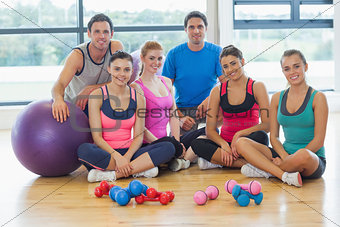 Portrait of fitness class at a bright exercise room