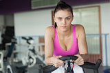 Portrait of a woman working out at spinning class