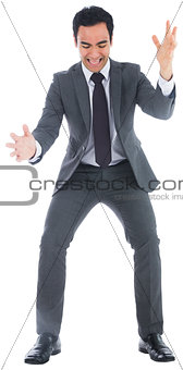 Screaming businessman catching