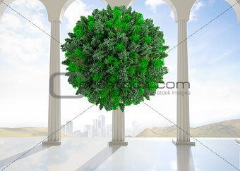 Green natural ball floating in room