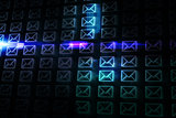 Glowing envelopes on black background
