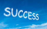 Success written in white in sky