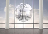 Silver globe floating in room
