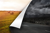Stormy background over sunny landscape background
