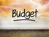 Budget written on wall with sky