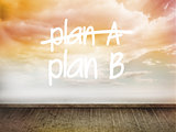 Plan a and b written on wall with sky