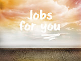 Jobs for you written on wall with sky