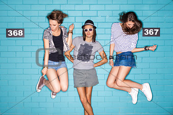 young people having fun in front of light blue brick wall