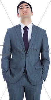 Unsmiling businessman standing