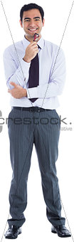 Smiling businessman holding glasses
