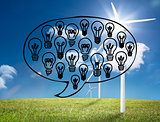Light bulbs graphic on bright countryside with wind turbines
