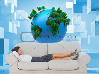Smiling business woman lying down on the couch