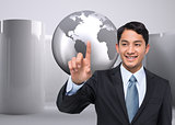Smiling asian businessman pointing