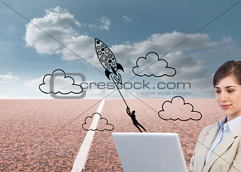 Composite image of businesswoman holding laptop