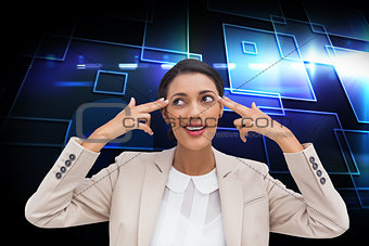 Composite image of young businesswoman pointing her head with her fingers