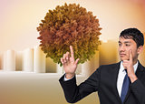 Composite image of businessman touching