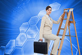 Composite image of businesswoman climbing career ladder and looking at camera