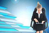 Composite image of businesswoman sitting on swivel chair with tablet