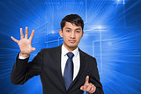 Composite image of businessman holding and pointing
