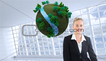 Composite image of young businesswoman sitting on ground