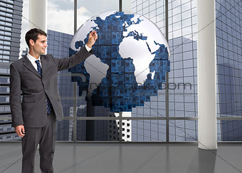 Composite image of businessman holding something up in the air