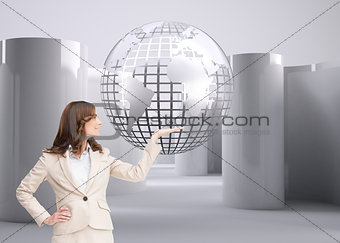 Composite image of businesswoman raising her hand